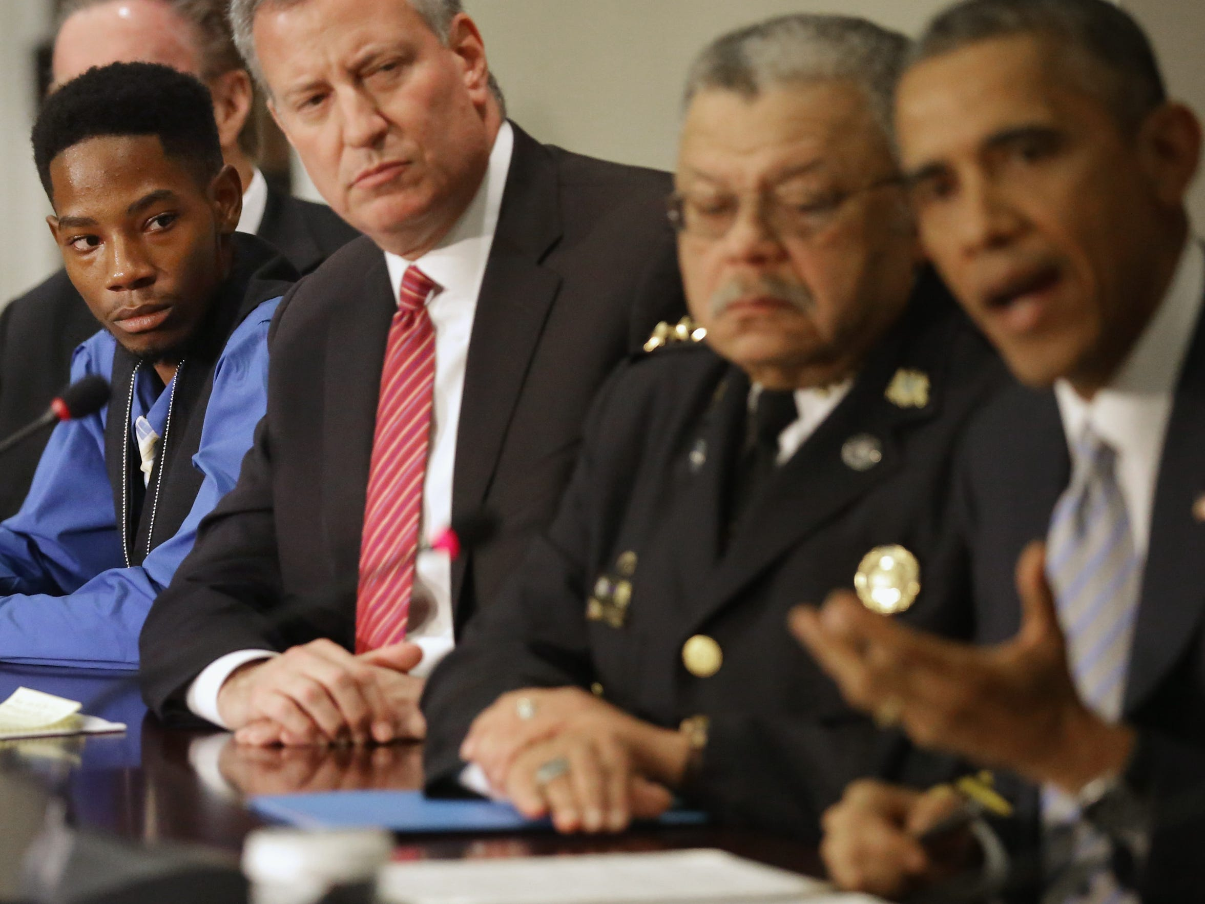 Rasheen Aldridge, far left, listens to President Obama, far right, at the conclusion of a meeting with New York Mayor Bill de Blasio, second from left, Philadelphia Police Department Commissioner Charles Ramsey and other elected officials on  Dec. 1, 2014, in Washington.