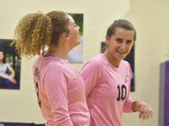 Sharing a lighthearted moment during a recent Plymouth Christian game are Devon Burns (left) and Ruth Doty (No. 10).