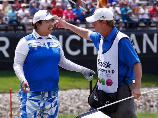 689451366.jpg ANN ARBOR, MI - MAY 28:  Shanshan Feng of China hugs her caddie after putting out on the 18th green to win the LPGA Volvik Championship on May 28, 2017 at Travis Pointe Country Club Ann Arbor, Michigan. (Photo by Gregory Shamus/Getty Images)