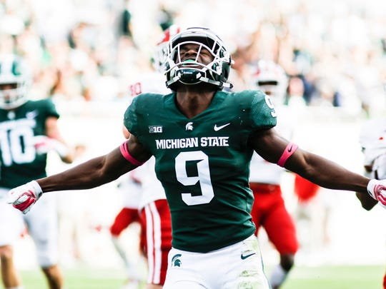 MSU safety Dominique Long celebrates an MSU stop during