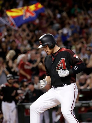 Arizona Diamondbacks Brandon Drury crosses the plate after hitting a two run home run against the Milwaukee Brewers during the sixth inning of a baseball game, Saturday, June 10, 2017, in Phoenix.