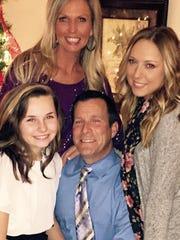 Brittany Sherfield with her mom, Katie, stepdad, John,