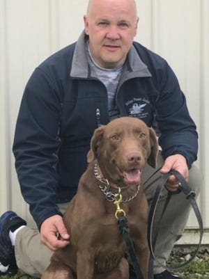Wausau Police Officer Mark Kurtzhals and the department's newest drug dog, Rio.