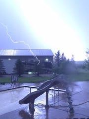Lightning strikes near Tea as a storm rode through