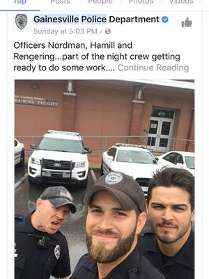 "Ex-Gainesville Police Department officer Michael Hamill, center, poses in the ""hot cop"" photo that went viral in September. Hamill has since resigned following allegations he made anti-Semitic Facebook posts and had sex with a woman while on duty."