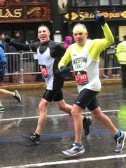 Chambersburg's Bill Dann and Chris Monheim charge toward the finish line of the Boston Marathon, eventually finishing with identical times of 3:13:08. Dann and Monheim, both 49, were Franklin County's fastest finishers.