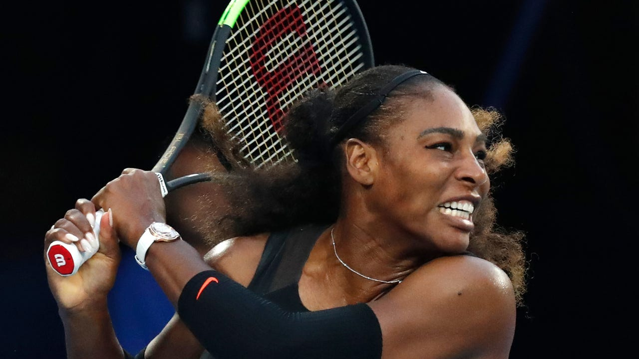 Serena Williams beat her sister Venus in straight sets to win the Australian Open and now stands alone as the all-time leader in women's Grand Slam titles in the Open Era.