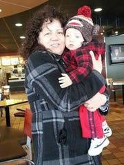 Tina Martz holds her grandson Rylyn Martz,  Daniel Martz's youngest son.