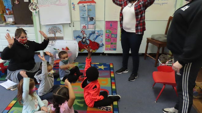 Preschool students at Project Discovery enjoy activities with their teachers.
