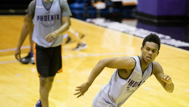 Former ASU guard Tra Holder runs a drill during the NBA draft prospect workout at Talking Stick Resort Arena in Phoenix on May 25, 2018.