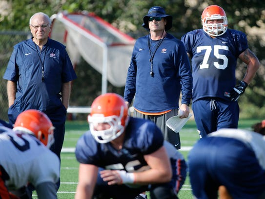 Interim head coach Mike Price stands with offensive