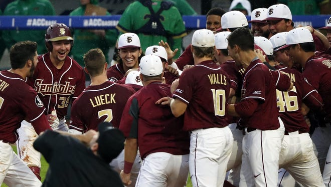 Florida State outfielder Jackson Luck (2) is congratulated by teammates after hitting a game-winning home run in the bottom of the 12th inning during the ACC baseball tournament in Louisville, Ky., on Wednesday.