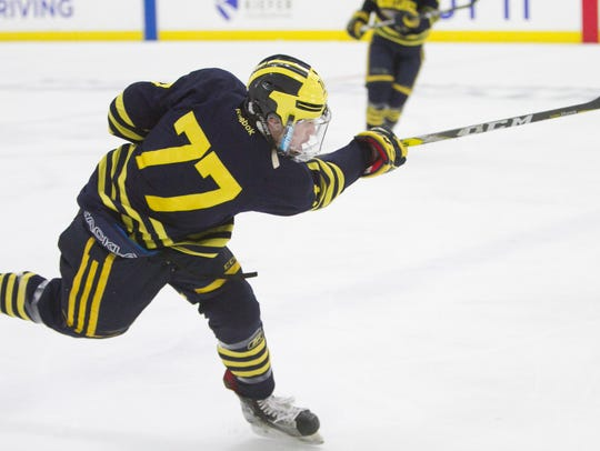 Hartland defenseman Jake DeYoung unleashes a shot in