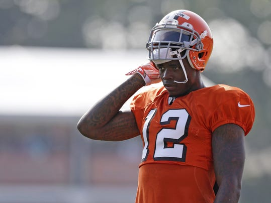 FILE - In this Aug. 4, 2014, file photo, Cleveland Browns wide receiver Josh Gordon rests during practice at the NFL football team's training campin Berea, Ohio. Gordon has been suspended by the NFL one year for violating the league's substance abuse policy. Gordon's suspension is effective immediately and he will miss the entire 2014 season.  (AP Photo/Tony Dejak, File)