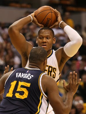 Lavoy Allen looks for an opening over Utah's Derrick Favors during the Utah Jazz at Indiana Pacers game, Saturday, October 31, 2015.