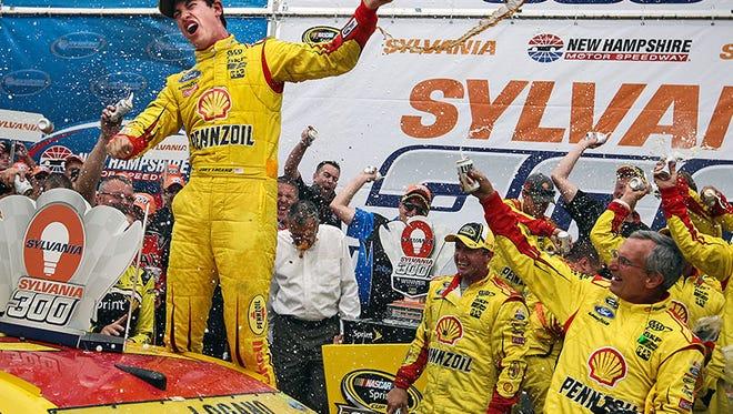 Joey Logano celebrates his win today on the NASCAR Sprint Car series.