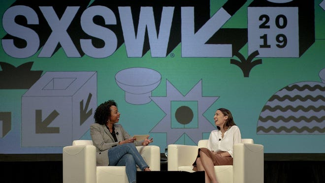 Rep. Alexandria Ocasio-Cortez, D-N.Y., speaks with Briahna Gray, a senior politics editor at The Intercept, during South by Southwest on March 9, 2019. This year's SXSW was canceled in March, it likely will be held only as a virtual event next year.