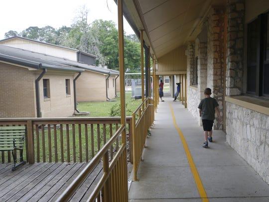 Children walk the outdoor halls at Woodville Elementary