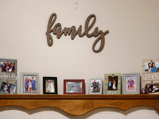 Photos of Samantha Huntley, who died of a heroin overdose on Sept. 3, adorn the walls and shelves of her mother's home just west of Springfield on Wednesday, Oct. 11, 2017.