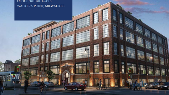 A local developer plans to convert a four-story warehouse