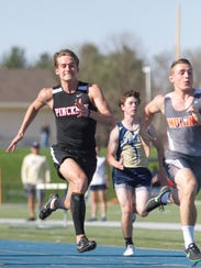 Nick Cain of Pinckney takes second place in the 100-meter
