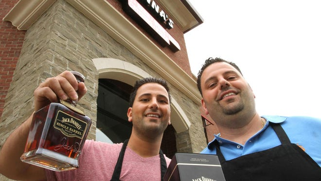 Patrick Jonna, left, and Michael Jonna, of Jonna's Market in Howell stand outside the business that took the top spot for liquor, beer and wine selection in the county in the 2017 People's Choice awards.