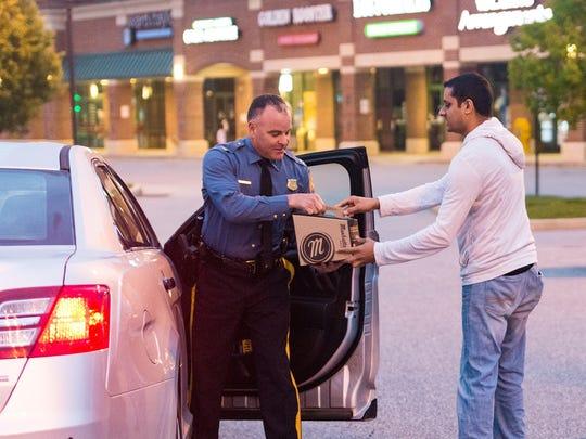Rishen Patel, owner of Manhattan Bagel, delivers coffee
