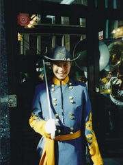 Jessi Teich pictured in 2002 standing at the ready to lead the North Hunterdon High School Marching Band in a New York City parade. She is dressed as Gen. Robert E. Lee for the band's Civil War theme.