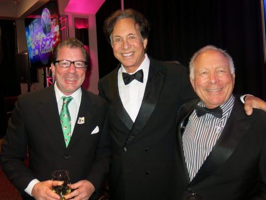 Christopher Phillips, Jeffrey Kallenberg, Fred Phillips at Las Vegas Night.