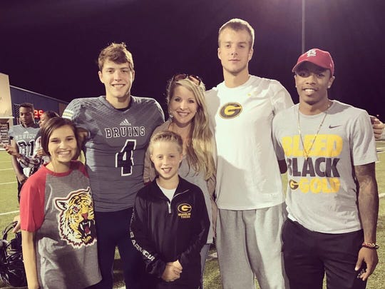 Wilks poses with family and friends at GSU athletic