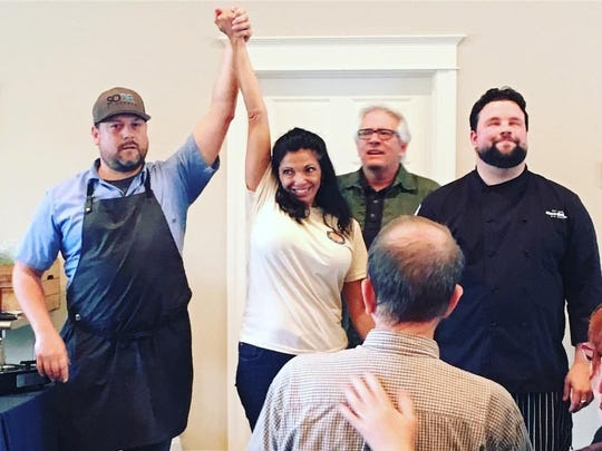 Festival organizer Stacy LaMotta declares chef Doug Ruley of SoDel Concepts the winner of the 2016 chef throwdown at the third annual Southern Delaware Wine, Food and Music Festival in Millsboro last year.