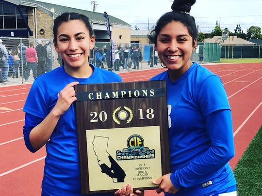 Sisters Alexys, left, and sophomore Ana Covarrubias celebrate the Fillmore High girls soccer team's CIF-Southern Section Division 7 championship at Warren High in Downey on March 3.