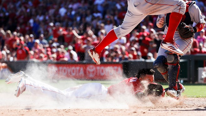 The Cincinnati Reds' Billy Hamilton, below, scores on an attempted steal at second and blown pickoff attempt caused by a throwing error by Boston Red Sox second baseman Dustin Pedrioa in the seventh inning of the game Sunday, Sept. 24, 2017, in Cincinnati.