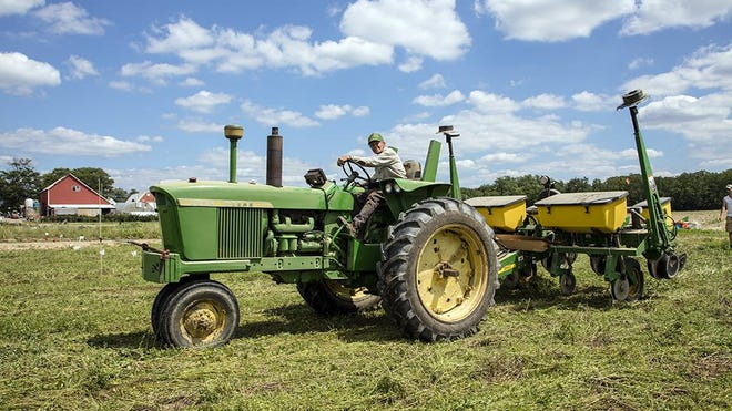 Man on tractor at Springdale Farms in Cherry Hill