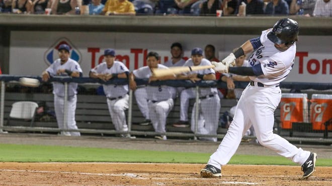 Pensacola's Beau Amaral smashes an RBI single against the Biloxi Shuckers at Blue Wahoos Stadium.