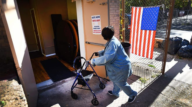 A voter arrives at Second Baptist Church in Paterson to cast her vote on Election Day.