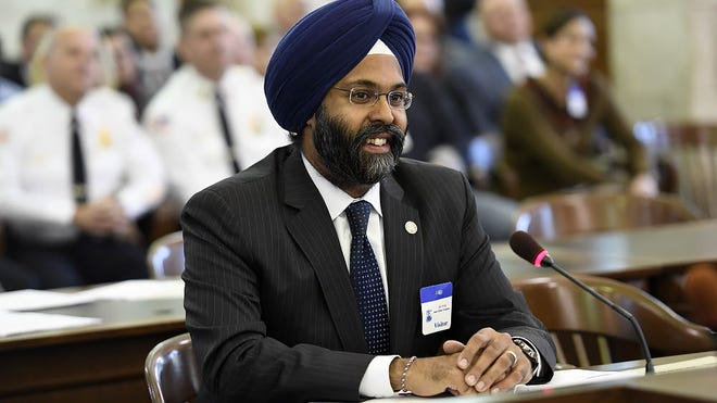 Gurbir S. Grewal smiles as senators within the State Senate Judiciary Committee voice their support to appoint Grewal to a full term after being the acting Bergen County Prosecutor since January on Thursday, Nov. 10, 2016.