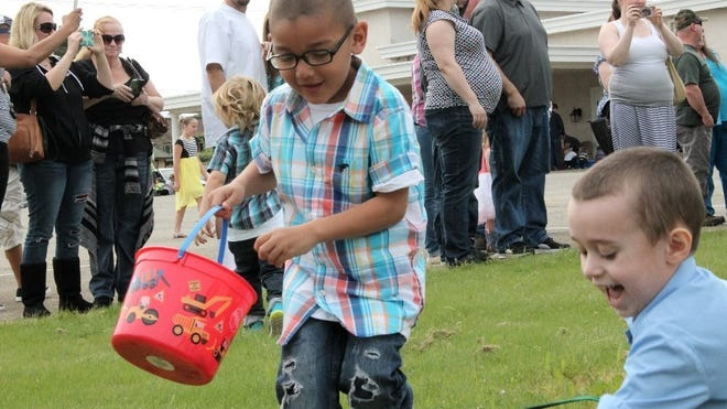 Keandre Thomas, 6 (center), hunts for eggs at the second annual Lawncrest Chapel Easter Egg Hunt.