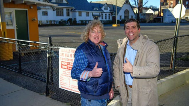 In this file photo, Richard Grabowsky, left, and attorney Jonathan T. Guldin stand in front of the Church Street parking lot, with the Unitarian Universalist Congregation at Montclair behind them.