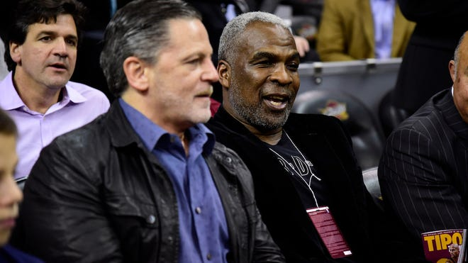 CLEVELAND, OH - FEBRUARY 23: Cleveland Cavaliers owner Dan Gilbert sits next to former NBA player  Charles Oakley prior to the game between the Cleveland Cavaliers and the New York Knicks at Quicken Loans Arena on February 15, 2017 in Cleveland, Ohio. NOTE TO USER: User expressly acknowledges and agrees that, by downloading and/or using this photograph, user is consenting to the terms and conditions of the Getty Images License Agreement. (Photo by Jason Miller/Getty Images)
