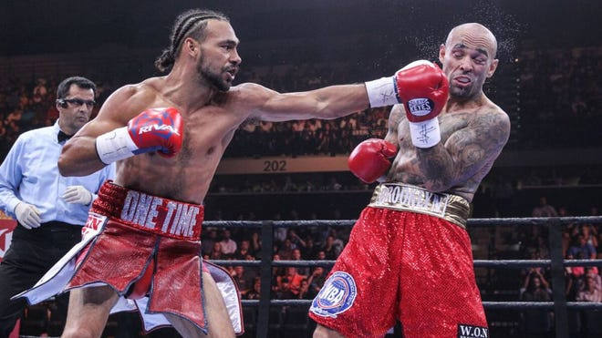 Keith Thurman throws a left jab that lands on the jaw of Luis Collazo Saturday night. (Photo: Lucas Noonan, PBC)