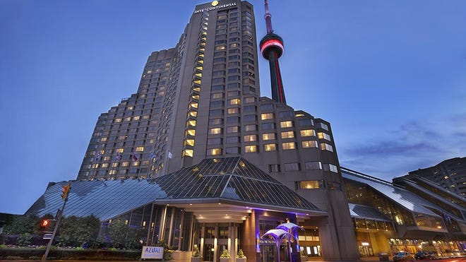 The CN tower observation attraction seems to rise from the Intercontinental Toronto Center.