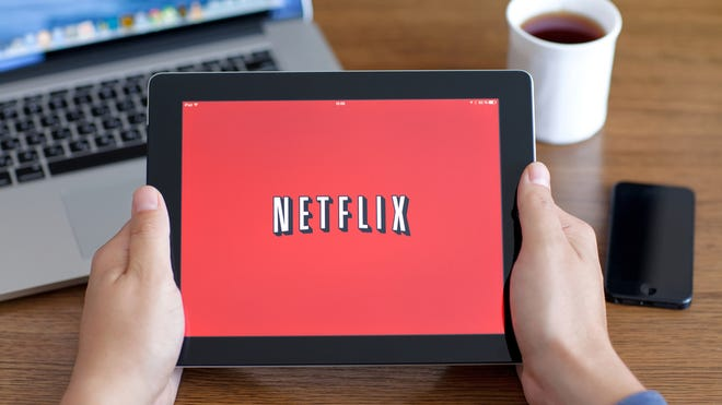 Simferopol, Russia - June 22, 2014: Netflix American company, a provider of films and TV series based on streaming media. The company was founded in 1997.