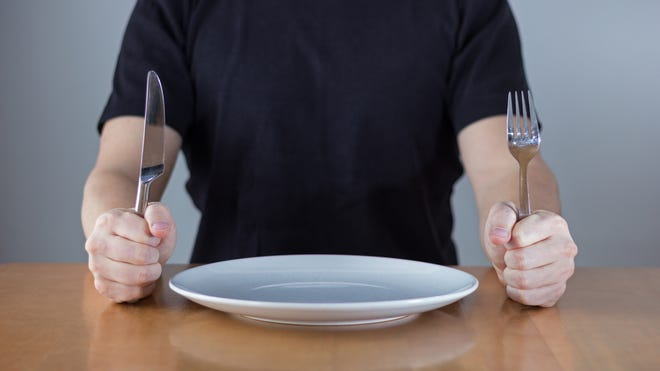 Fasting with religious purpose is an ancient practice. But going without a few meals to improve your health is a recent trend gaining attention. Be aware of the pros and cons before committing to an intermittent fast.