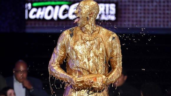Legend Award winner Danica Patrick completely covered in gold slime