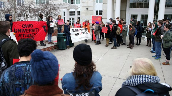 Ohio University students protest the guaranteed tuition hike, as voted on by the university's Board of Trustees, that will raise the tuition costs of incoming freshman by 5% outside of Baker University Center on Thursday, Jan. 22, 2015. Protestors began outside the first floor of Baker University Center and then blocked traffic on Court Street and College Street. They ended their protests at the Civil War monument after police asked them to leave the street or be arrested.