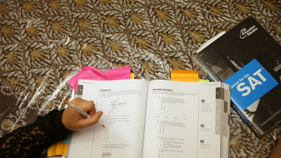 Suzane Nazir uses a Princeton Review SAT Preparation book to study for the test on March 6, 2014 in Pembroke Pines. (Photo by Joe Raedle/Getty Images)