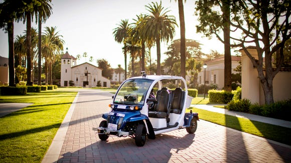 Auro Robotics shuttle on display in front of the Mission Church at Santa Clara University on Aug. 21, 2015.