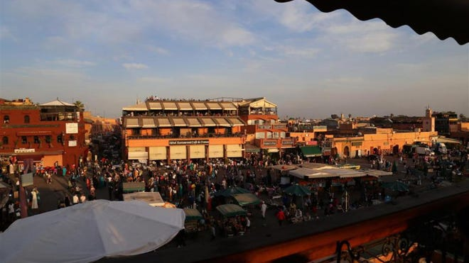 A view of Marrakech's main square, Jemaa el Fna from a rooftop terrace by day.