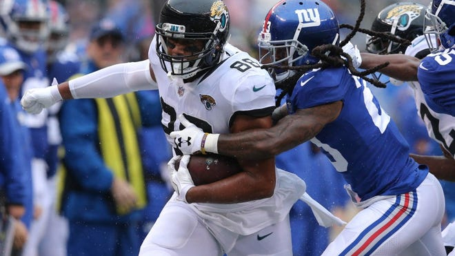 Sep 9, 2018; East Rutherford, NJ, USA; Jacksonville Jaguars tight end Austin Seferian-Jenkins (88) runs with the ball against New York Giants corner back Janoris Jenkins (20) during the second quarter at MetLife Stadium. Mandatory Credit: Brad Penner-USA TODAY Sports